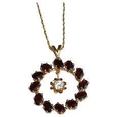 14 K Yellow Gold Circle 6.60 CTW Garnet And 0.50 Carat Floating Simulated Diamond Pendant/Necklace