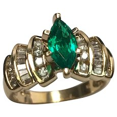 Beautiful 14 k Yellow Gold .75 Carat Marquise Cultured Emerald And Diamond Ring