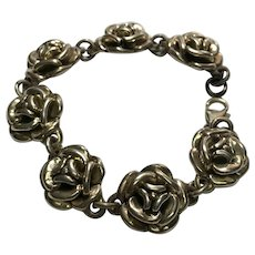 Sterling Silver Repoussee Flower Link bracelet