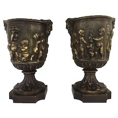 Pair of 19th Century French Bronze Urns After Clodion