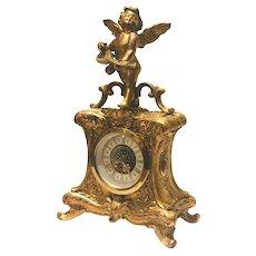 Antique Gilt Metal Mantle Clock with Cherub Statuette