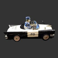 1950's KO Yoshiya Japan Bump 'N Go Tin Litho Police Car