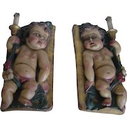 Pair of Polychromed Carved Wood Putti, early years 20th century