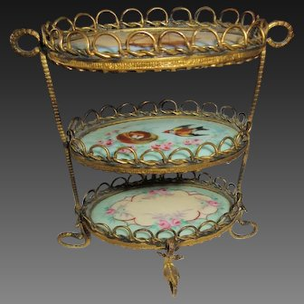 Golden metal and hand painted porcelain , small etagere, Huret period ?