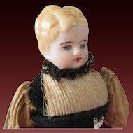 all original in folkloric costume : Parian . 8 1/2 in . bisque arms & legs