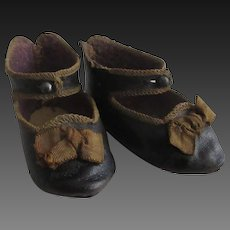 Jumeau size 8 . pair of antique leather shoes . length 2 3/4 in