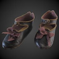 Jumeau size 12 . pair of antique leather shoes . length 4 1/8 in