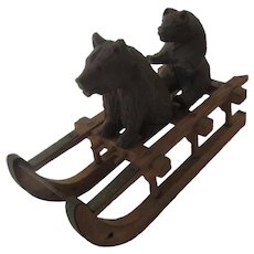 2 Bears on a sledge . antique toy in black forest carved wood