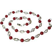 18K gold necklace with round coral beads.