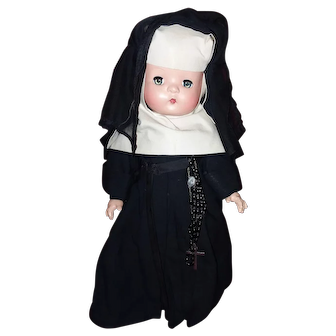 Vintage composition Nun doll