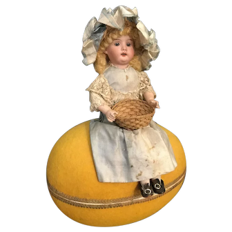 Antique doll Easter candy container