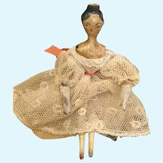 Early miniature tuck comb wood doll in dome