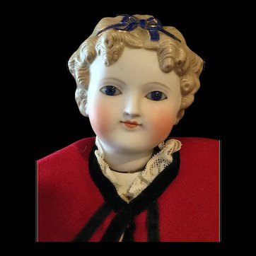 A very rare glass eyed Parian doll with jointed neck
