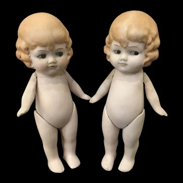 Pair of all bisque jointed Googly dolls