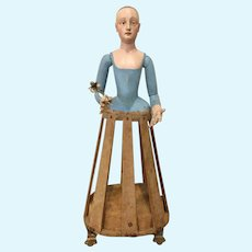 Early wood saint figure with cage base