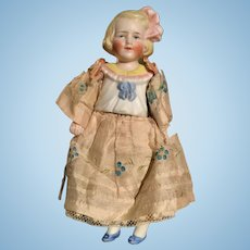 Antique German bisque miniature doll by Hertwig