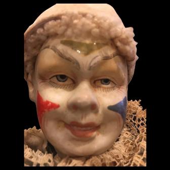Antique paper mache clown doll