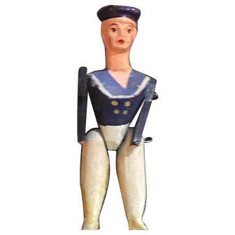 Tiny antique wood doll