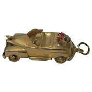 Vintage 14 karat Gold Charm for bracelet Convertible Automobile with moving wheels.