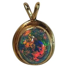 Exceptional 14K Solid Black Opal Pendant Every color in the Rainbow