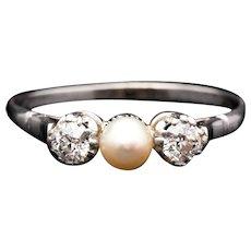 Edwardian Platinum Diamond, and Natural Pearl Three Stone Ring