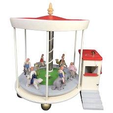 1950's Germany FAO Schwarz Wooden Musical Merry-go-round w Caco doll children