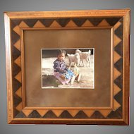 Framed Color Photograph of Native American Girl with Doll and Lambs