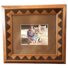 Framed Color Photograph of Native American Girl with Lambs