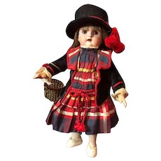 Charming Bisque Head Child Doll with Fantastic Wardrobe and Domed Trunk