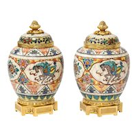 Exquisite Pair of French Ormolu-Mounted Chinese Style Porcelain Vases and Covers