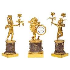 Rare French Gilt-Bronze Ormolu and Porphyry Three-Piece Clock Set, circa 1880