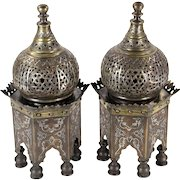 """Pair of Islamic temple-form incense burners, inlaid with silver and copper, 12"""" h x 5 1/2"""" w."""