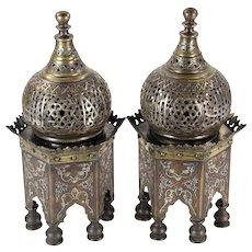 "Pair of Islamic temple-form incense burners, inlaid with silver and copper, 12"" h x 5 1/2"" w."