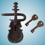 Violin shaped cast iron lock with keys