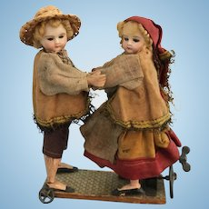 7 Inch Antique German Mechanical Wind Up Dancing Couple on Platform-All Original