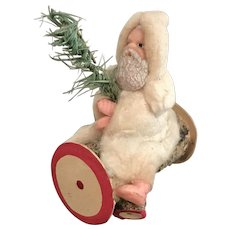 5 Inch Antique German Santa Claus Sitting on a Log Candy Container