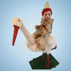 """16"""" German Stork Candy Container with Bisque Doll Rider c. 1910"""