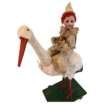 "16"" German Stork Candy Container with Bisque Doll Rider c. 1910"