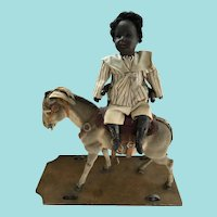 Antique German Bisque Black African Americana Doll riding on Donkey