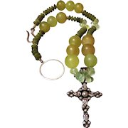 A Multi-Colored Prehnite Bead Necklace featuring a Rhinestone Cross