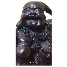 Beautifully carved laughing Buddha..