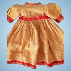 """Antique calico doll dress measures 11 1/4"""" down the front from neck to hem bottom."""