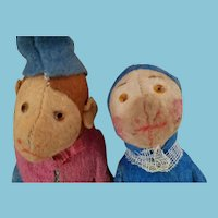 Colorful pair of antique felt characters, straw-filled