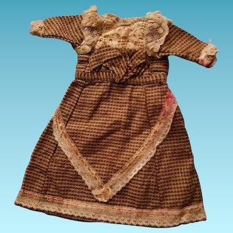 "11"" Long antique brown wool? print doll's dress."