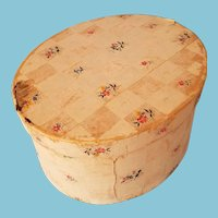 Antique 1800s folk art floral wallpaper-covered wooden oval box, lined with old newspaper,