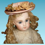 Charming pink silk doll bonnet or hat with floral trims for antique doll