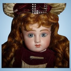 Antique french doll early Series Steiner bebe in antique couturier clothing with spiral blue eyes