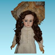 Most beautiful antique Depose Jumeau bebe french doll with stunning blue eyes and fabulous extended length antique wig