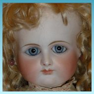 Spectacular early antique french doll by Petit and Dumoutier with blue spiral eyes