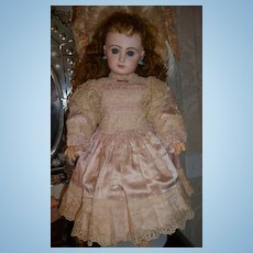 Extraordinary original antique french doll dress of pink silk satin circa 1880-1885